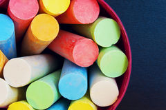 Crayons for drawing in a bucket top view stock images