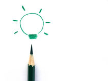 Crayons drawing light bulb, business idea concept Royalty Free Stock Photo