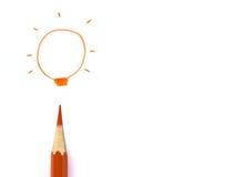 Crayons drawing light bulb, business idea concept Stock Photos