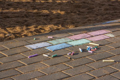 Crayons for drawing on the pavement. And flagstones Royalty Free Stock Photos