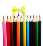 Crayons et réveil Photos libres de droits