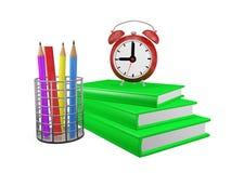 Crayons et réveil de livres Photos libres de droits