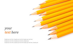 Crayons et texte pointus en bois Photos stock