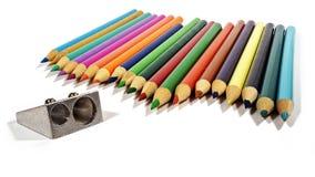 Crayons et une affûteuse Images stock