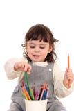 crayons flickan arkivbild