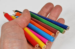 Crayons in hand Stock Image