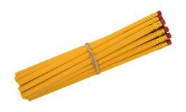 Crayons jaunes avec une bande élastique Photographie stock libre de droits
