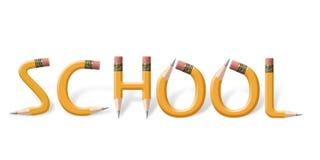 Crayons jaunes orthographiant l'école Images stock