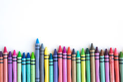 Crayons lined up isolated on white background Royalty Free Stock Photos