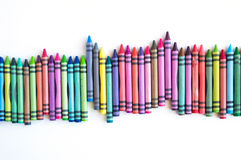 Crayons lined up isolated on white background Royalty Free Stock Photo
