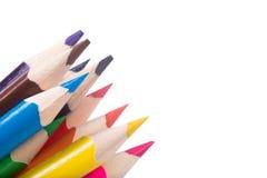 Crayons lumineux de couleur sur le fond blanc Photos libres de droits