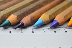 Crayons and meter Royalty Free Stock Photos