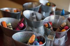 Crayons in mini milk tins stock photography