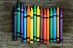 Crayons. Multicolored crayons on a wooden background royalty free stock photo