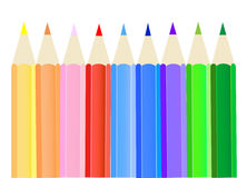 Crayons. Nine colored pencils lying on the table Royalty Free Stock Photography