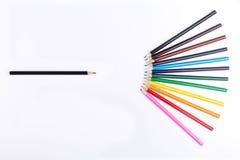 Crayons noirs et colorés Images libres de droits
