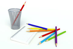 Crayons and notebook Royalty Free Stock Images