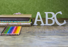 Crayons and notebooks Royalty Free Stock Images