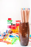 Crayons and other tools. Crayons, paint, brushes, colored pencils and other tools for drawing on white backgrounds Stock Photos