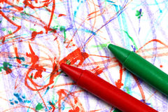 Crayons on paper. Multicolored crayons on a multicolored background Royalty Free Stock Photography