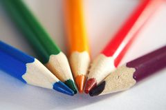 Crayons on paper board. With tips together Royalty Free Stock Photo