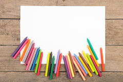 Crayons and paper on the desk Royalty Free Stock Photo