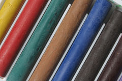 Crayons pastels in different colors. Royalty Free Stock Photos