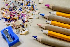Crayons and pencil sharpener on a wooden office table. Crayons w Stock Photography