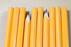 Crayons and pencil sharpener on a wooden office table. Crayons w Royalty Free Stock Images