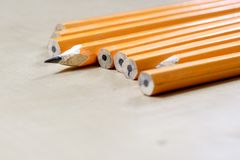 Crayons and pencil sharpener on a wooden office table. Crayons w Royalty Free Stock Photos