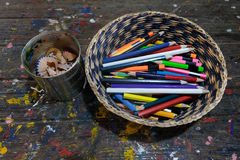 Crayons and pencil shells Royalty Free Stock Photography