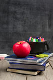 Crayons (pencils) in a mug with chalkboard Royalty Free Stock Photo
