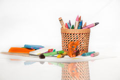 Crayons, plasticine and paintbrush Stock Photo