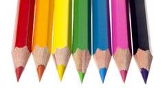 Crayons pointus de couleur sur le blanc Photographie stock