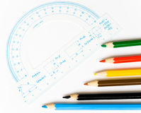 Crayons and protractor Royalty Free Stock Photo