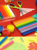 Crayons on a red desk Stock Images