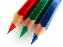 Crayons RGB. RGB  wooden crayons against white background Stock Image