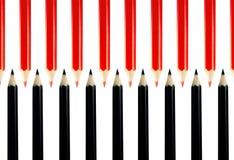 Crayons rouges et noirs Photographie stock libre de droits