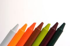 Crayons in a row. Seven colorful crayons aligned against a white background stock photography