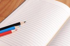 Crayons, a ruler and Notepad closeup Stock Image