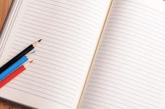 Crayons, a ruler and Notepad closeup Stock Photography