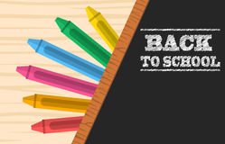 Crayons and school blackboard Stock Image