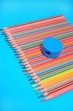 Crayons and sharpener Stock Photos