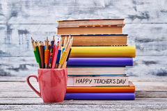 Crayons and stack of books. Enjoy Teacher`s Day Royalty Free Stock Photo