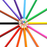 Crayons stack circle on a white. Background royalty free stock photos