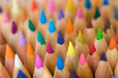 Crayons standing together. A lot of colorful crayons standing together royalty free stock image