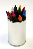 Crayons on steel outer view. Multicolored crayons in a stainless steel can on a white background Stock Photos