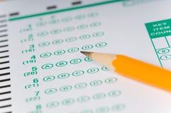 Crayons sur l'examen Photographie stock libre de droits