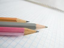 Crayons sur le copy-book Photographie stock