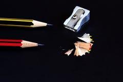 Crayons sur le noir Image stock